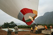 Hot Air Balloon Prints - Launching A Hot Air Balloon Print by Photostock-israel