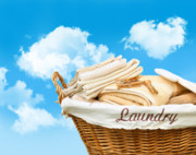 Basket Framed Prints - Laundry basket  against a blue sky Framed Print by Sandra Cunningham