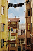 Hanging Laundry Framed Prints - Laundry Drying On  Line Framed Print by Hulya Ozkok