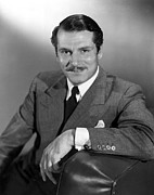 Olivier Framed Prints - Laurence Olivier, Portrait Framed Print by Everett