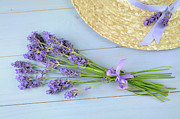 Tied-up Framed Prints - Lavender Bunch And Straw Hat On Wooden Table Framed Print by Cora Niele