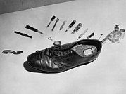 Hiding Photos - Law Enforcement Photo Of A Shoe by Everett