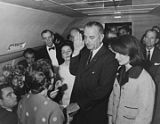 World Leader Photo Prints - LBJ Taking The Oath On Air Force One Print by War Is Hell Store