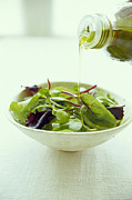 Pour Framed Prints - Leaf Salad With Olive Oil Framed Print by David Munns