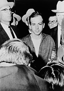 Candid Portraits Prints - Lee Harvey Oswald Escorted By Officers Print by Everett