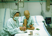 Patient Prints - Leukaemia Patient & Mother Play Cards In Hospital Print by Geoff Tompkinson