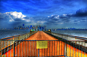 Liberty Island Framed Prints - Liberty Island Dock with Manhattan in background Framed Print by Randy Aveille