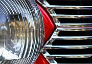Car Framed Prints - Light And Grill Framed Print by Dan Holm