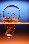 Glass Photo Posters - Light Bulb And Splash Water Poster by Setsiri Silapasuwanchai