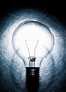 Stainless Steel Photo Prints - Light Bulb On Stainless Steel Background. Print by Ballyscanlon