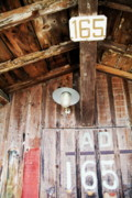 Bassin Art - Light hanging inside an old wooden hut by Sami Sarkis