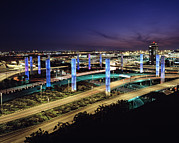 Airport Architecture Prints - Lighted Pylons Along Century Boulevard Print by Everett