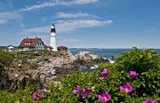 Portland Head Lighthouse Framed Prints - Lighthouse with Rocks on Shore Framed Print by Bill Bachmann and Photo Researchers