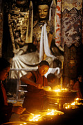 Verticals Prints - Lighting Puja Candles - Jokhang Temple Tibet Print by Craig Lovell