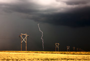 Summer Scene Framed Prints - Lightning striking behind Saskatchewan power line Framed Print by Mark Duffy