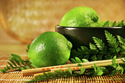 Dine Posters - Limes with chopsticks Poster by Sandra Cunningham