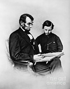 John Wilkes Booth Framed Prints - Lincoln Reading To His Son Framed Print by Photo Researchers