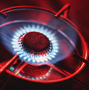 Home Appliance Posters - Lit Gas Ring Poster by Tek Image