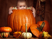 Carved Pumpkin Prints - Little Baby Boy Sitting Inside a Large Pumpkin Print by Oleksiy Maksymenko