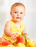 Food And Beverage Prints - Little baby choosing fruits Print by Anna Omelchenko