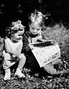 Boys And Girls Posters - Little Boy & Girl Reading Comic Strips Outside Poster by George Marks