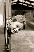 Arial Posters - Little boy leaning out of a train window Poster by Tom Gowanlock
