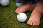 Golf Ball Posters - Little Feet Poster by Emily Stauring