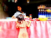 Shopping Photo Framed Prints - Little Girl Candy Shopping in Ubud  Framed Print by Funkpix Photo  Hunter