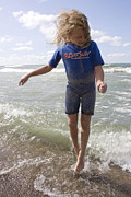Avoid Contact Photo Prints - Little girl jumping in the surf in Lake Michigan Print by Purcell Pictures
