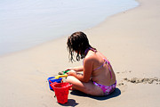 Innocent People Prints - Little Girl Playing In Sand On Beach Print by Susan Stevenson