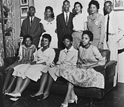 Civil Rights Photo Posters - Little Rock Nine And Daisy Bates Posed Poster by Everett