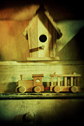 Interior Still Life Prints - Little wooden train on shelf Print by Sandra Cunningham
