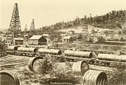 Barrels Prints - Loading An Oil Train Print by Everett