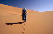 Mature Adult Photos - Local Man Walking In The Sahara by Olivier Cirendini
