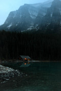 Lake Louise Photos - Log cabin by the lake by Pierre Leclerc