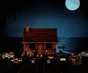 Log Cabins Prints - LOG CABIN midnight ocean view with full moon Print by Leslie Crotty