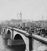 Carriages Posters - London Bridge showing carriages - coaches and pedestrian traffic - c 1900 Poster by International  Images