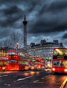 Cloudy Sky Photos - London red buses by Jasna Buncic