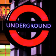 Red And Black Prints - London Underground Sign Print by Tony Grider