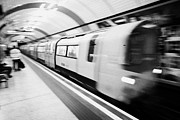 London Underground Posters - London Underground Train Arriving In Station England United Kingdom Uk Deliberate Motion Action Blur Poster by Joe Fox