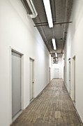 Flooring Framed Prints - Long Corridor With Closed Doors Framed Print by Eddy Joaquim