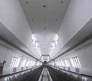 Escalator Framed Prints - Long Walkway with Escalators Framed Print by Yali Shi