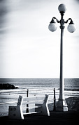Lamppost Framed Prints - Looking to the Sea Framed Print by John Rizzuto