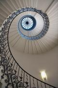 Staircase Railing Framed Prints - Looking Up At A Spiral Staircase Framed Print by Axiom Photographic