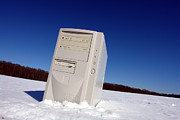 Mobile Framed Prints - Lost Computer in Snow Framed Print by Olivier Le Queinec