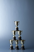 Balance In Life Posters - Loving Cup Trophies Stacked In A Pyramid Poster by Larry Washburn