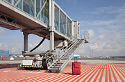 Airport Architecture Prints - Luggage at a Gate Bridge Print by Jaak Nilson