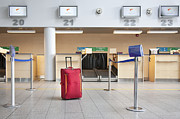 Tallinn Airport Photo Posters - Luggage at an Airline Check-In Counter Poster by Jaak Nilson