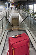 Airline Industry Photos - Luggage at the Top of an Escalator by Jaak Nilson