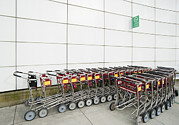 Order Prints - Luggage Carts In A Row Print by Marlene Ford